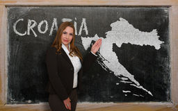 Teacher showing map of croatia on blackboard Royalty Free Stock Photography