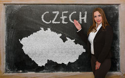 Teacher showing map of czech on blackboard. Successful, beautiful and confident young woman showing map of czech on blackboard for presentation, marketing Royalty Free Stock Image