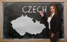 Teacher showing map of czech on blackboard Royalty Free Stock Image