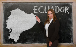 Teacher showing map of ecuador on blackboard. Successful, beautiful and confident young woman showing map of ecuador on blackboard for presentation, marketing Royalty Free Stock Images