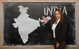 Teacher showing map of india on blackboard Stock Photo