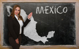 Teacher showing map of mexico on blackboard. Successful, beautiful and confident young woman showing map of mexico on blackboard for presentation, marketing Stock Photos