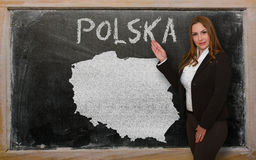 Teacher showing map of poland on blackboard Royalty Free Stock Photography
