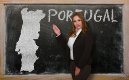 Teacher showing map of portugal on blackboard. Successful, beautiful and confident young woman showing map of portugal on blackboard for presentation, marketing Royalty Free Stock Images