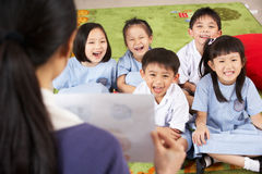 Teacher Showing Painting To Chinese Students Stock Photography