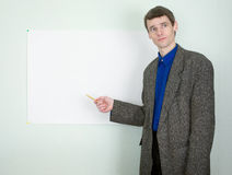 Teacher showing on the poster Stock Images