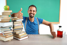 Teacher showing thumbs up and hand gesture no: Yes Education - No Alcohol. Stock Photos