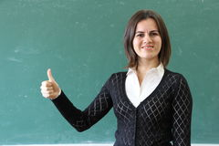Teacher showing thumbs up sign. Stock Photography