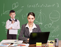 Teacher sitting at the desk Royalty Free Stock Photo