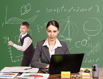 Teacher sitting at the desk Stock Photos