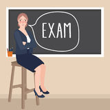 Teacher sitting in front of class writing exam in blackboard Royalty Free Stock Photography