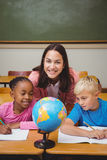 Teacher sitting with her students Royalty Free Stock Images