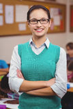 Teacher smiling at camera in classroom Stock Photography