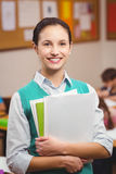 Teacher smiling at camera in classroom Royalty Free Stock Photography