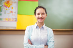 Teacher smiling at camera in classroom Stock Images