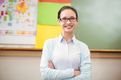 Teacher smiling at camera in classroom Stock Photos