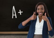 teacher smiling with thumbs up stock images