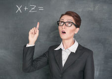 Teacher solving equation Stock Image
