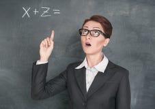 Teacher solving equation Stock Image