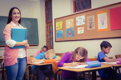 Teacher Standing By Her Students Royalty Free Stock Photos