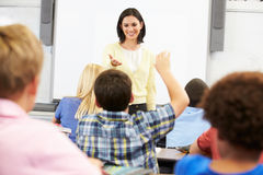 Teacher Standing In Front Of Class Asking Question Stock Images