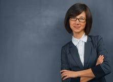 Teacher is standing near blackboard Royalty Free Stock Photos