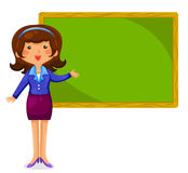 Happy teacher. Teacher standing next to a blackboard Stock Photos