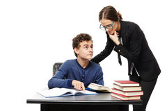 Teacher standing next to the student's desk  and the student poi Stock Photo