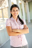 Teacher standing outside school building Stock Image