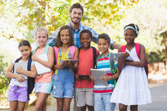 Teacher standing with school kids royalty free stock images