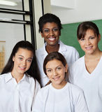 Teacher Standing With Schoolgirls In Lab Royalty Free Stock Photography