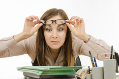 The teacher stares at the pile of notebooks Royalty Free Stock Photos