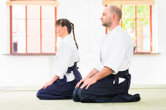 Teacher and student at Aikido martial arts school stock photography