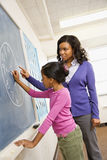Teacher and Student at Blackboard Royalty Free Stock Photo