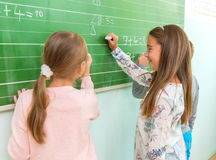 Teacher and student at the blackboard, math class Royalty Free Stock Photography