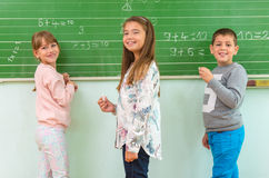 Teacher and student at the blackboard, math class Stock Photography