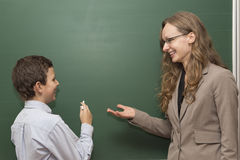 Teacher and student at the board Stock Photography