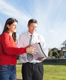 Teacher And Student With Books Standing On Campus Royalty Free Stock Photography