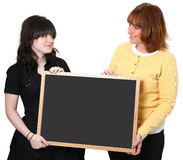 Teacher and Student with Chalkboard. Smiling teacher and student holding chalkboard Royalty Free Stock Photography