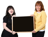 Teacher and Student with Chalkboard over White. Happy teacher and student holding blank chalkboard over white Stock Image