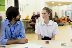 Teacher and Student Chatting Royalty Free Stock Images