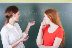Teacher and student on chemistry lesson Royalty Free Stock Photos