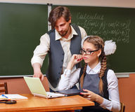 Teacher and student in the classroom calculus. Royalty Free Stock Images