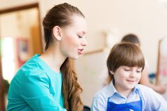 Teacher and student in the classroom Stock Photos