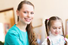 Teacher and student in the classroom Stock Photography