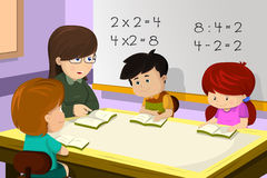 Teacher and student in the classroom. A vector illustration of kids studying math in classroom with teacher Stock Photography