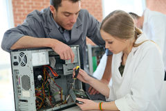 Teacher and student during computing class Stock Photo