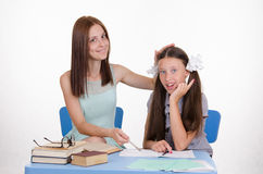 Teacher and student decide to homework Stock Images