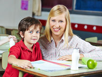 Teacher and student in elementary Stock Photo