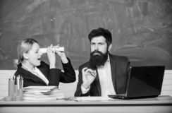 Teacher and student on exam. back to school. formal education. businessman and secretary. paper work. office life. Business couple use laptop and documents stock photography